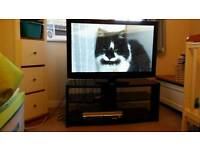 Pansonic 42 inch lcd hd tv and black glass tv unit