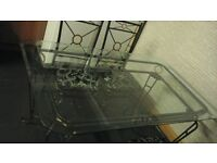 glass table and chairs and matching coffee table