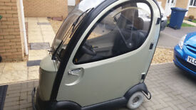 traveso inclosed disability scooter/car.