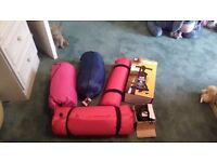 Fornsale we have 2 brand new sleeping bags, 2air beds and electric pump , hand pump