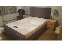 King size double bed frame (mattress not included) with padded head board; grey in colour