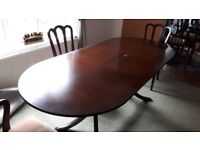 Solid Mahogany extendable dining table and 4 chairs (Moving home clear out sale! Lots of bargains)