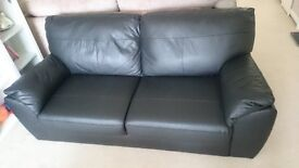 Large black leather 2-seater sofa in excellent condition