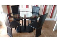 SMART OVAL GLASS TABLE WITH 4 FAUX LEATHER CHAIRS IN EXCELLENT CONDITION