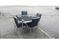 Glass top table with 4 black leather chairs £85 delivered free in belfast