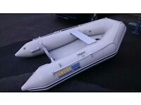 Excel 260SD Inflatable Dinghy with inflated floor and keel, oars, pump, carry bag. 5 air chambers.