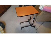 Adjustable table for bedside or armchair meals