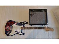 Fender Squier Strat guitar and amplifier