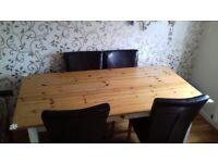 Large solid pine table and 4 leather look chairs good condition needs collectig asap