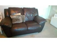 2 seater brown leather sete. In very good condition. To pick up. 50 pound ono. Fire safe