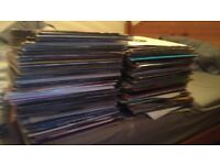 "12 "" vinyls. Over 220 of them in amazing condition."