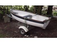 """9'6"""" rowing boat, on adjustable road trailer, with 4HP outboard and oars"""
