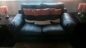 2 seater black sofa neally new.
