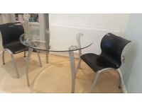 Round glass dining table and 2 chairs