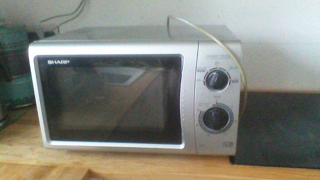 Microwave oven 850w, medium capacity, grey colour, good condition