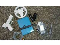 BLUE NINTENDO WII WITH GAMES AND ACCESSORIES