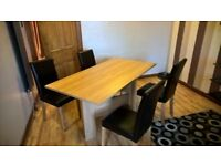 next oak effect table and 4 chairs