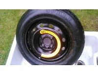 As new space saver tyre and rim.