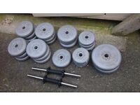 Assortment of weight discs approx 112 LB in total