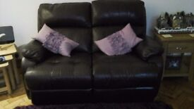 A pair of dark brown leather 2 seater sofa's
