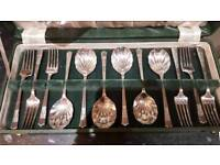 Set of dessert spoons, forks and serving spoon