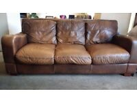 Sofa: Brown Leather 3 to 4 Seater Rollback Sofa.
