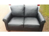 Black faux leather two seater sofa/settee rounded arms