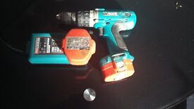 makita 14.4 drill with 2 good batteries and charger