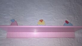 Beautiful pink shelf with pretty cup cake detail