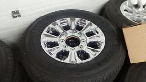 "Ford F250  18""  chrome alloy factory wheels  tires new."