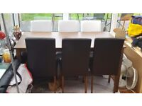 Dining table and 6 black faux leather chairs