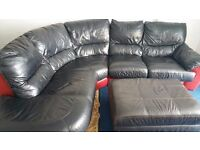 BLACK & RED LEATHER VERY COMFY CURVED CORNER SOFA.