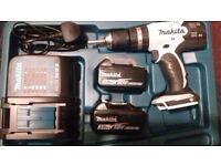 White Makita battery drill