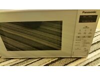 Brand New Panasonic microwave with company manual and accessories only £39