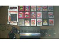 Atari 2600 console + 2 joysticks and over 20+ games and more