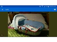 Moses basket with white wooden stand