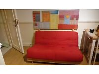 Red Futon from Argos with free IKEA canvas print