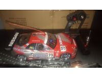 RC NITRO 1:10 SCALE TRAXXAS CAR, VERY FAST ALL SET UP TO GO NEW WHEELS THIS CAR IS ELECTRIC START