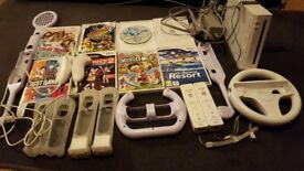 Wii console, plus 7 games, and accessories