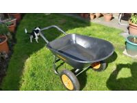 Wheel barrow. Two wheel wheelbarrow hardly used.