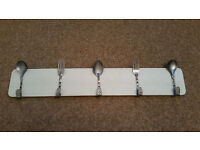 Kitchen Towel Holder Rack, wall mounted, hanger hooks in the shape of spoons and forks.