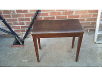 brown wood stool with brown leather padded seat