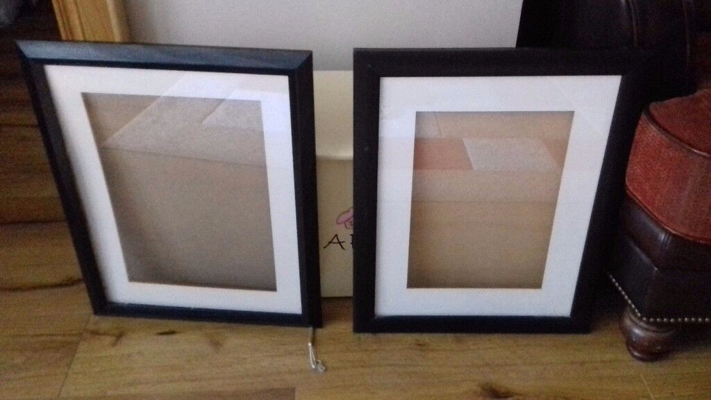 16 x 20 black photo frames with borders.