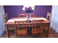 Solid Oak Dining Table and 6 Chairs. Classic feature piece for the home. 180 by 90 cms