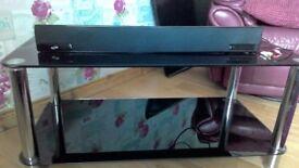 Black glass tv table and soundbar
