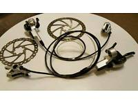 Mountain bike shimano gears and hydraulic brakes. And rotors.