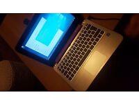 "Purple HP 11'6"" touch screen"