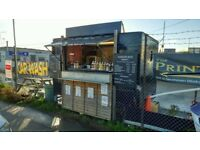 burger van and pitch for sale located in a busy carwash