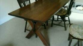 Solid Dutch Oak Table & Chairs 6 complete with cushions, in good condition.