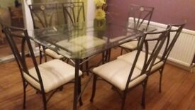 Glass top dining table and six chairs